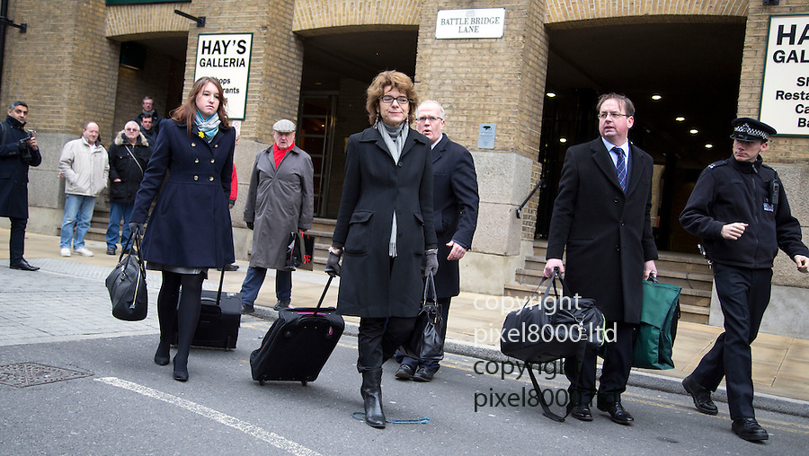 Vicky Pryce arrives with her going away bag on her way into court for sentence today.11.3.13.carrying a rose from a well wisher...Pic by Gavin Rodgers/Pixel 8000 Ltd