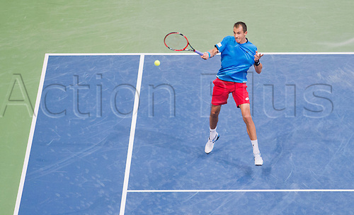 06.03.2016. Hannover, Germany.  Lukas Rosol of the Czech Republic returns a ball to Alexander Zverev of Germany during their match at the Davis Cup World Group first round tie between Germany and Czech Republic at the TUI Arena in Hanover, Germany, 06 March 2016.