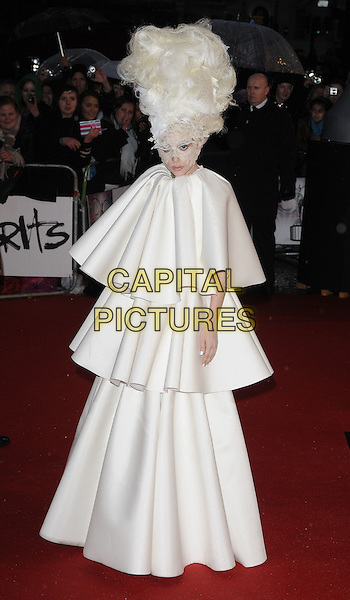 LADY GAGA (Stefani Joanne Angelina Germanotta).Arrivals the Brit Awards 2010 held at Earls Court, London, England..February 16th 2010 .Brits full length wig white cream tiered layered layers maxi dress lace face mask hair.CAP/CAN.©Can Nguyen/Capital Pictures.