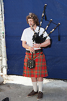 A man plays a bagpipe near the World Trade Center construction site.