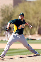 Brett Anderson #49 of the Oakland Athletics pitches a live batting practice session in spring training workouts at the Athletics complex on February 23, 2011  in Phoenix, Arizona. .Photo by:  Bill Mitchell/Four Seam Images.