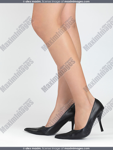 Sexy woman legs in high heel shoes isolated on white background