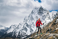 Hiking Cho La Pass, 5420 meters, part of the 3 Passes Tour, with views of Cholatse. Nepal.