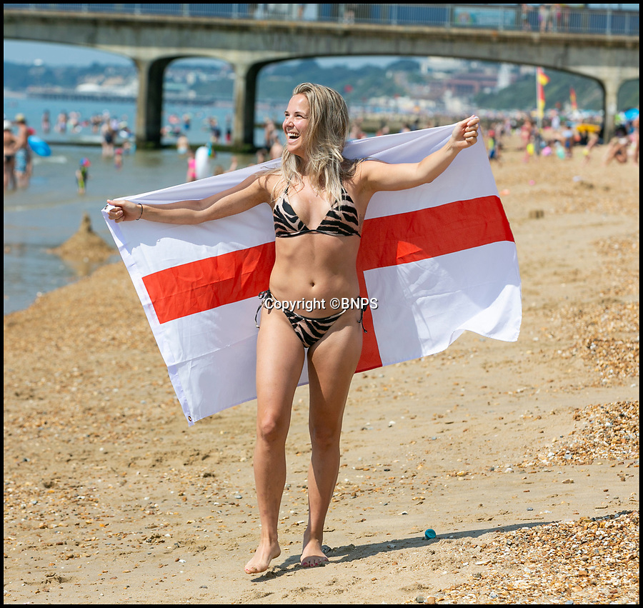 BNPS.co.uk (01202 558833)<br /> Pic: LeeMcLean/BNPS<br /> <br /> Lisa Holmback (26- originally from Sweden) is now flying the flag for England after yesterdays win. <br /> <br /> Sizzling Sunday in Bournemouth as football fever gripped the seaside resort after England win to take them into the Semi-Finals of the World Cup.