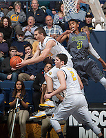 David Kravish of California rebounds the ball during the game against UC Irvine at Haas Pavilion in Berkeley, California on December 2nd, 2013.  California defeated UC Irvine, 73-56.