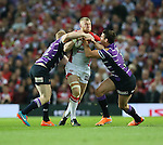 St Helens Luke Thompson is  tackled by Wigan Warriors Joel Tomkins and Wigan Warriors - First Utility Super League Grand Final - St Helens v Wigan Warriors - Old Trafford Stadium - Manchester - England - 11th October 2014 - Pic Paul Currie/Sportimage