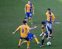 Luke O'Nien of Wycombe Wanderers takes on a group of Mansfield players during the Sky Bet League 2 match between Wycombe Wanderers and Mansfield Town at Adams Park, High Wycombe, England on 25 March 2016. Photo by Andy Rowland.