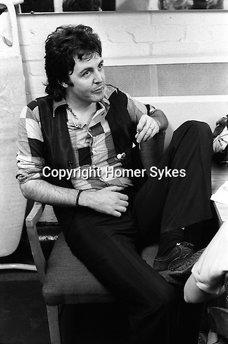"Paul and Linda McCartney Wings Tour  1975. Paul in rehearsal dressing room, Elstree London England. The photographs from this set were taken in 1975. I was on tour with them for a children's ""Fact Book"". This book was called, The Facts about a Pop Group Featuring Wings. Introduced by Paul McCartney, published by G.Whizzard. They had recently recorded albums, Wildlife, Red Rose Speedway, Band on the Run and Venus and Mars. I believe it was the English leg of Wings Over the World tour. But as I recall they were promoting,  Band on the Run and Venus and Mars in particular."
