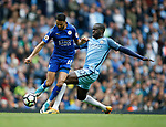 Riyad Mahrez of Leicester City tackled by Yaya Toure of Manchester City during the English Premier League match at the Etihad Stadium, Manchester. Picture date: May 13th 2017. Pic credit should read: Simon Bellis/Sportimage
