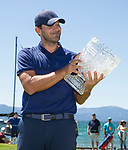 Tony Romo smiles with the trophy after winning the ACC Golf Tournament at Edgewood Tahoe Golf Course in South Lake Tahoe on Sunday, July 14, 2019.