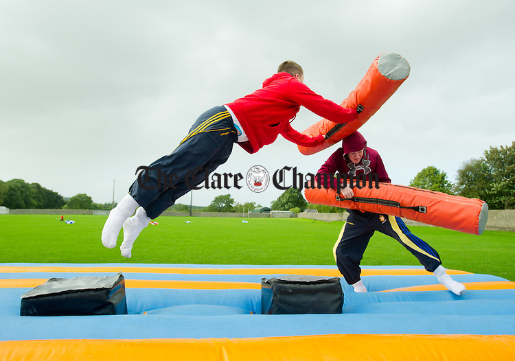 Jamie Keane lunges at Jack Madden during the Clare Shout Festival Field day in Kilkishen. Photograph by John Kelly.
