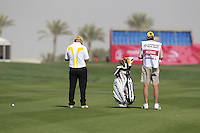 Damien McGrane (IRL) and caddy John Horte on the 10th hole during Friday's Round 3 of the Commercial Bank Qatar Masters 2013 at Doha Golf Club, Doha, Qatar 25th January 2013 .Photo Eoin Clarke/www.golffile.ie