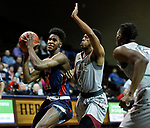 SIOUX FALLS, SD - MARCH 9:  Isaak Rowe #31 of Oklahoma Wesleyan drives on Grant Leach #4 of IU East at the 2018 NAIA DII Men's Basketball Championship at the Sanford Pentagon in Sioux Falls. (Photo by Dick Carlson/Inertia)