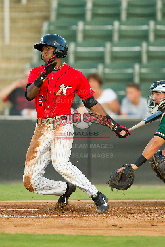 Tim Anderson (2) of the Kannapolis Intimidators follows through on his swing against the Greensboro Grasshoppers at CMC-Northeast Stadium on July 15, 2013 in Kannapolis, North Carolina.  The Intimidators defeated the Grasshoppers 4-0.   (Brian Westerholt/Four Seam Images)