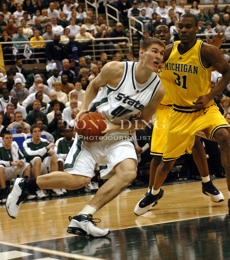 Spartan Paul Davis (40) takes the baseline in a layup attempt during the Wolverines' 54-71 loss to Michigan State on Saturday, January 17, 2004 at the Breslin Center in East Lansing. Davis was the Spartan's lead scorer in the game, combining for 22 points. (TONY DING / The Michigan Daily)