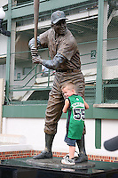 August 9, 2009:  A young fan hugs the leg of a statue depicting Hall of Fame member Ernie Banks (Mr. Cub) after a game at Wrigley Field in Chicago, IL.  Iowa is the Pacific Coast League Triple-A affiliate of the Chicago Cubs.  Photo By Mike Janes/Four Seam Images