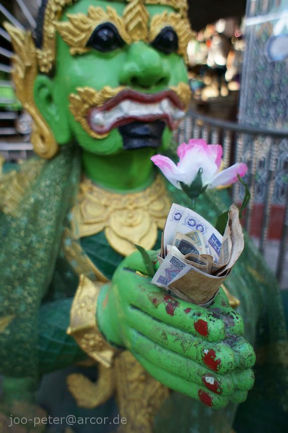 demon-spirit praying to Buddha,  Mandalay hill Pagoda complex , Mandalay, Myanmar, 2011