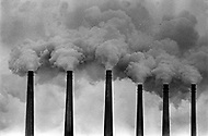 Lansing, MI. March 1973. Chimneys spew polluted smoke at Oldsmobile factory.