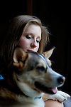 Angela Behnken's husband John, 27, died suddenly from the H1N1, swine flu, in November. She said she spends more time with his friends now so she can catch some of his sense of humor that she misses so and laugh again. She sits with her dog Rufus in her home in Johns Creek, Georgia April 22, 2010..