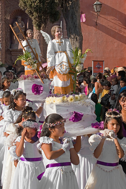 MEXICAN ANGELS with float leave TEMPLO DEL ORATORIO DE SAN FELIPE NERI during EASTER PROCESSION - SAN MIGUEL DE ALLENDE, MEXICO .