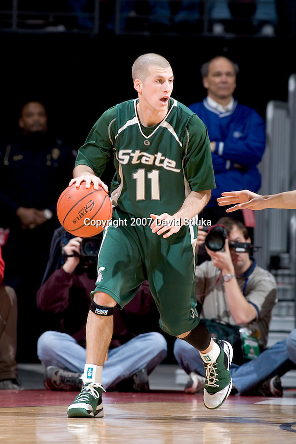 MADISON, WI - MARCH 03: Guard Drew Neitzel #11 of the Michigan State Spartans handles the ball against the Wisconsin Badgers during their Big Ten Conference game at the Kohl Center on March 3, 2007 in Madison, Wisconsin. The Badgers beat the Spartans 52-50. (Photo by David Stluka)