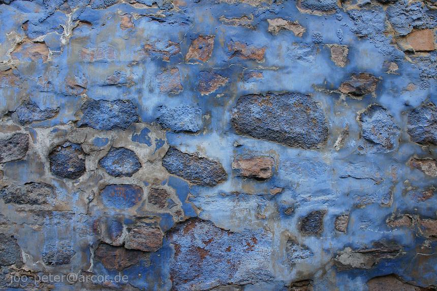 blue wall in the streets of Jodhpur,  Rajastan, India