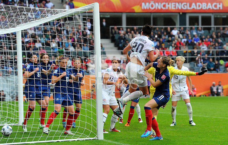 Abby Wambach (r) of team USA scores 2:1 against goalkeeper Berangere Sapowicz of team France during the FIFA Women's World Cup at the FIFA Stadium in Moenchengladbach, Germany on July 13th, 2011.