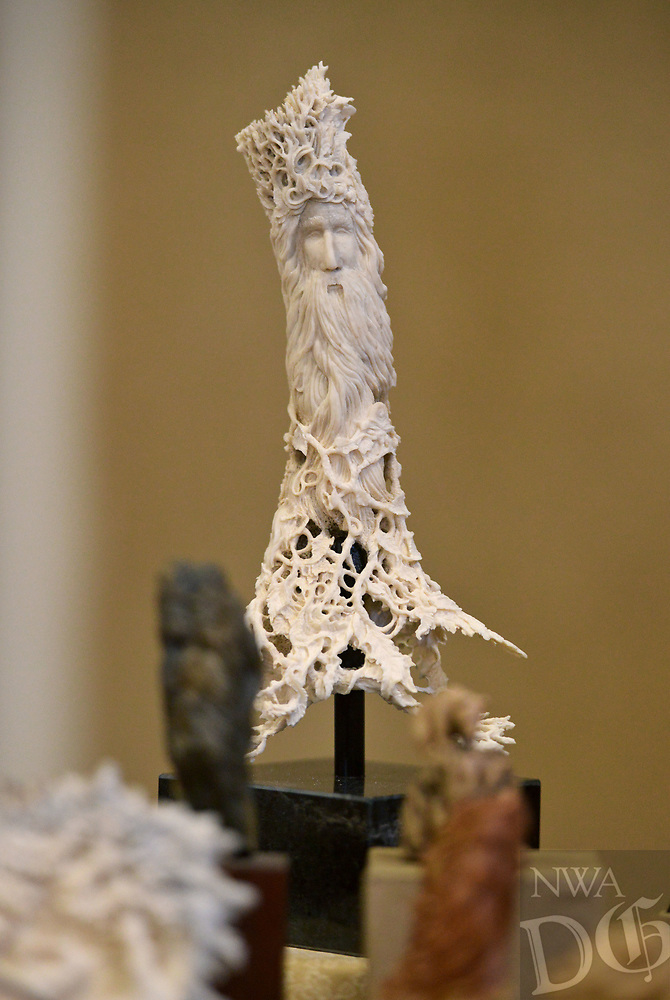NWA Democrat-Gazette/BEN GOFF @NWABENGOFF<br /> A carving in deer antler by Pennie Hanke of Bella Vista sits on display at her table Saturday, July 15, 2017, during the Bella Vista Woodcarvers Club's Artistry in Wood Show at Bella Vista Assembly of God church. Members of the club exhibited and sold their woodwork at the show, which also included door prizes, demonstrations and a people's choice award.