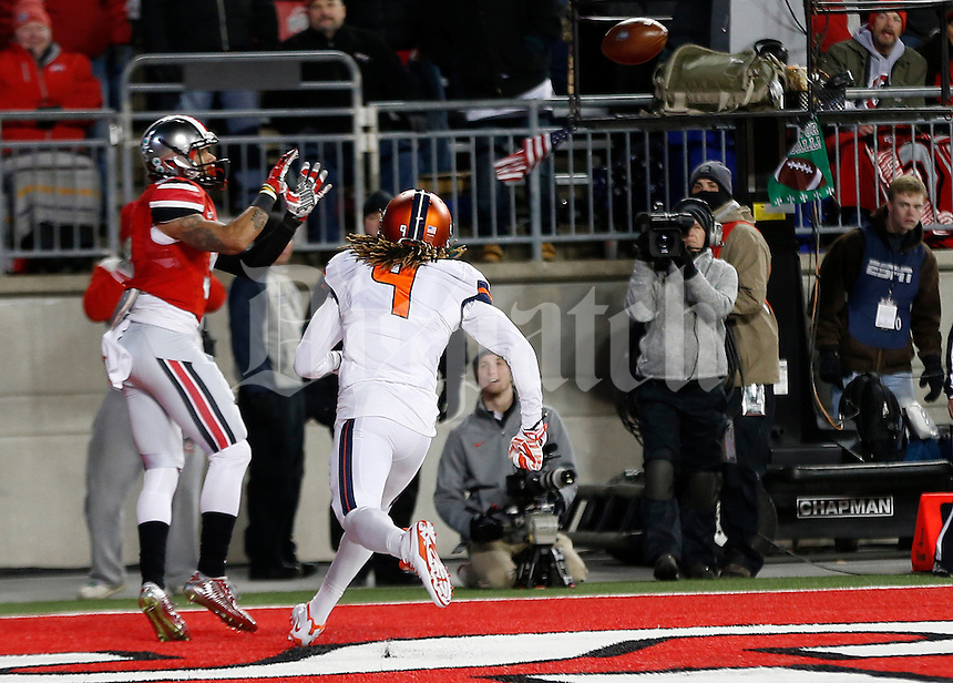 Ohio State Buckeyes wide receiver Devin Smith (9) catches a touchdown pass under pressure from Illinois Fighting Illini defensive back Earnest Thomas III (9) in the second quarter the college football game between the Ohio State Buckeyes and the Illinois Fighting Illini at Ohio Stadium in Columbus, Saturday night, November 1, 2014. (The Columbus Dispatch / Eamon Queeney)