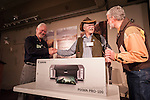 Shooting the West XXV, Winnemucca, Nev...Stuart Scofield and Gordon Allen draw the winning evaluation for the Canon Pixma Pro 100 Printer door prize...Winner of the printer, Dan Stevenson of Elko, Nev.