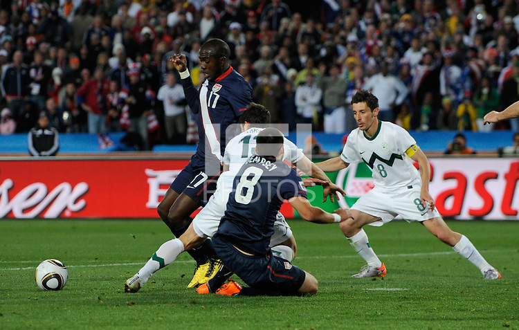 Jozy Altidore of USA is brought down in the box by Bojan Jokic of Slovenia, no penalty was given by referee Koman Coulibaly, ony a yellow card