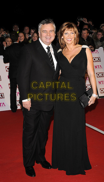 EAMONN HOLMES & RUTH LANGSFORD .arriving at the National Television Awards held at the Royal Albert Hall,  London, England, 29th October 2008..red carpet arrivals full length black dress suit tie married husband wife .CAP/FIN.©Steve Finn/Capital Pictures