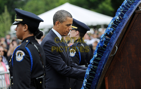 United States President Barack Obama attends the 32nd Annual National Peace Officers' Memorial Service at the West Front Lawn of the U.S. Capitol May 15, 2013 in Washington, DC. Barack Obama attended the annual event to honor law enforcement who were killed in the line of duty in the previous year. .half length .CAP/ADM/CNP/OD.©Olivier Douliery/CNP/AdMedia/Capital Pictures