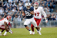 STATE COLLEGE, PA - SEPTEMBER 30:  Penn State RB Saquon Barkley (26) runs for a gain past Indiana defenders. The Penn State Nittany Lions defeated the Indiana Hoosiers 45-14 on September 2, 2017 at Beaver Stadium in State College, PA. (Photo by Randy Litzinger/Icon Sportswire)