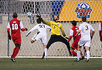 Patrick Hodan (27) of Notre Dame scores on Michael Lisch (0) of New Mexico during the NCAA Men's College Cup semifinals at PPL Park in Chester, PA.  Notre Dame defeated New Mexico, 2-0.