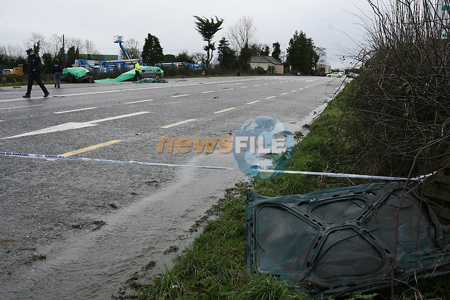 Another Fatal accident on the Roads in Co Meath.  A BMW car collided with an articulated lorry on the N2 north of Ashbourne at Kilmoon cross. The BMW was coming from the Duleek, Drogheda Direction when it failed to stop at the junction with the N2 as A Lorry was passing and collieded with it hiting it, behing the front wheels. There were four occupants in the car, One of the occupants was fataly injured at the scene, A second was removed by ambulance to Our lady of Lourdes hospital in Drogheda in a critical condtion, And the other two occupants were also removed by ambulance to Drogheda. Emergency services from Ashbourne and Drogheda used cutting equipment to remove some of the casulties from the recked vehicle...Garda inspect the scene in daylight...Photo: Newsfile/Fran Caffrey.