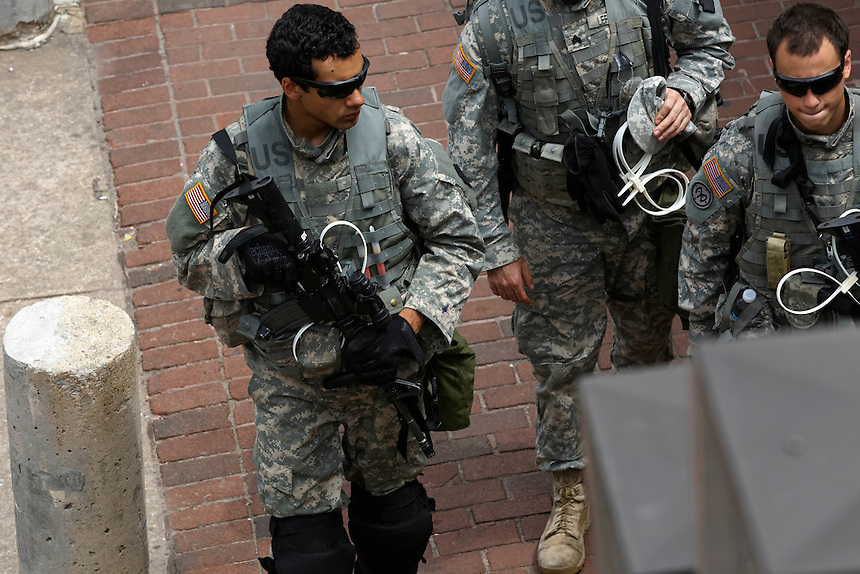 Heavily armed National Guard troopers patrol in Baltimores' inner harbor, April 30, 2015. to go with Nick O'Malley story.  photo by Trevor Collens