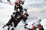 St. Louis Blues center Jaden Schwartz (9) and Calgary Flames right wing Lee Stempniak (22) bump each other in the first period during a game between the Calgary Flames and the St. Louis Blues on Thursday April 25, 2013 at the Scottrade Center in downtown St. Louis.