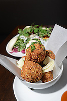 An order of Arancini (Almond crusted green apple pumpkin risotto fritters with gazpacho dipping sauce and dry aged goat cheese) at Blue Sage Vegetarian Grille Thursday August 13, 2015 in Southampton, Pennsylvania. (Photo by William Thomas Cain)