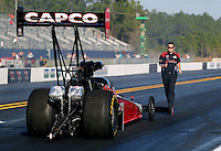 Mar 14, 2014; Gainesville, FL, USA; Crew member Gary Pritchett guides NHRA top fuel dragster driver Steve Torrence back to the starting line after the burnout during qualifying for the Gatornationals at Gainesville Raceway Mandatory Credit: Mark J. Rebilas-USA TODAY Sports