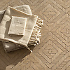 Rattan, a hand-cut tumbled mosaic, shown in Lagos Gold, is part of the Tissé® collection for New Ravenna.
