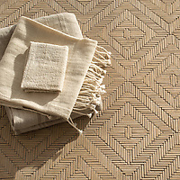 Rattan, a hand-cut tumbled mosaic, shown in Lagos Gold, is part of the Tissé™ collection for New Ravenna.