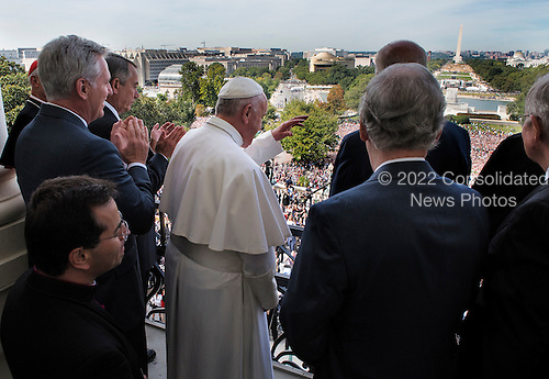 Pope Francis, center, waves to crowds after making remarks, flanked by House and Senate leadership as well as local clergy on the balcony of the Speaker of the House after he delivered an address to a joint session of Congress on September, 24, 2015 in Washington, DC.<br /> Credit: Bill O'Leary / Pool via CNP