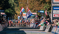 compact peloton crossing the finish line for another local lap<br /> <br /> MEN UNDER 23 ROAD RACE<br /> Kufstein to Innsbruck: 180 km<br /> <br /> UCI 2018 Road World Championships<br /> Innsbruck - Tirol / Austria