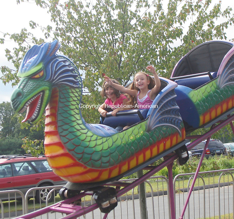 CHESHIRE, CT - 13 SEPTEMBER 2008 091308JW04.jpg -- Rose Grieco age 6 and Rachel Diglio age 6 ride the rollercoaster during the Kiwanis Club of Cheshire Carnival at Bartlem Park Saturday afternoon. Jonathan Wilcox Republican-American