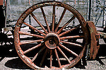 CA: Death Valley National Park, Furnace Creek Ranch, Harmony Borax Works, old borax mining wagon wheel                 .Photo by Lee Foster, lee@fostertravel.com, www.fostertravel.com, (510) 549-2202.Image: cadeat213