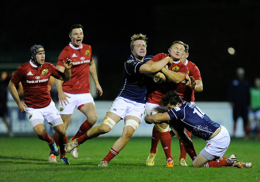 Munster A's Cian Bohane is tackled by London Scottish's Andrew Turner <br /> <br /> Photographer Ashley Western/CameraSport<br /> <br /> Rugby Union - British &amp; Irish Cup Pool 3 - London Scottish vs Munster A - Friday 13th November 2015 - Athletic Ground, Richmond <br /> <br /> &copy; CameraSport - 43 Linden Ave. Countesthorpe. Leicester. England. LE8 5PG - Tel: +44 (0) 116 277 4147 - admin@camerasport.com - www.camerasport.com