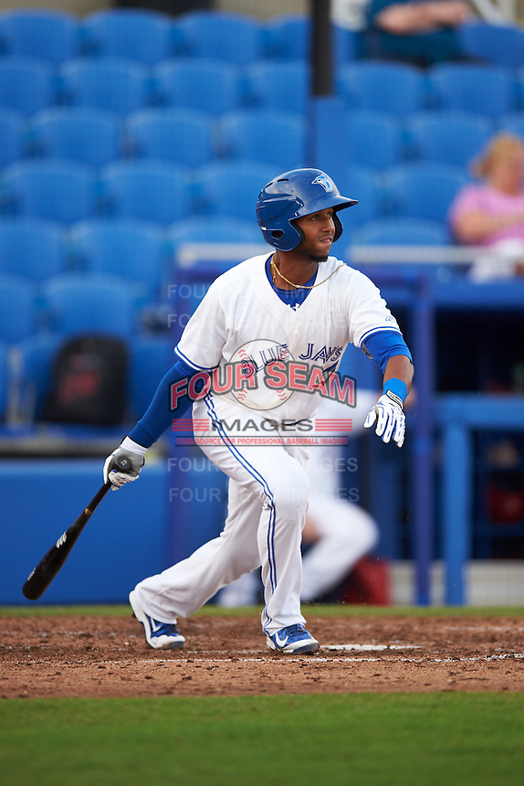 Dunedin Blue Jays shortstop Richard Urena (5) at bat during a game against the Palm Beach Cardinals on April 15, 2016 at Florida Auto Exchange Stadium in Dunedin, Florida.  Dunedin defeated Palm Beach 8-7.  (Mike Janes/Four Seam Images)