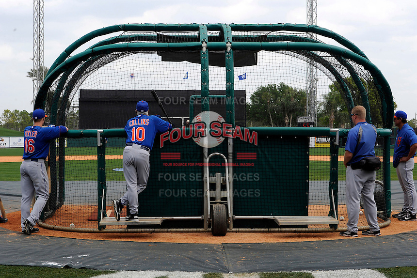 New York Mets manager Terry Collins #10 watches the hitters in the cage along with Brian Bixler #16 and other Mets staff before a Spring Training game against the Detroit Tigers at Joker Marchant Stadium on March 11, 2013 in Lakeland, Florida.  New York defeated Detroit 11-0.  (Mike Janes/Four Seam Images)