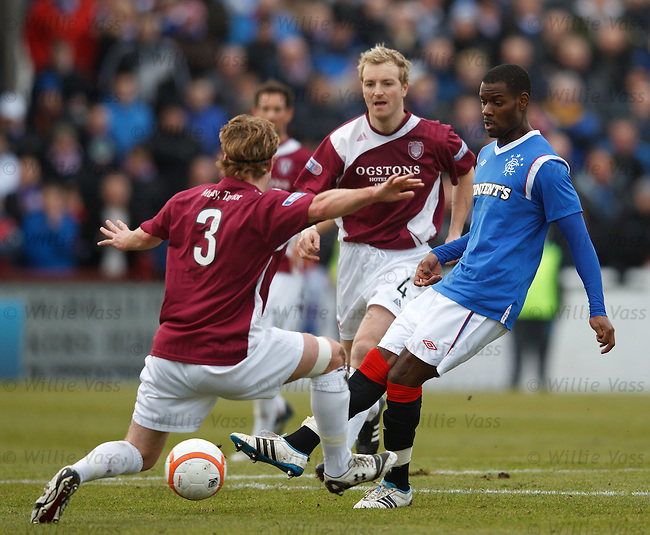 Maurice EDu takes the ball past Kieran McAnespie and Brian Kerr